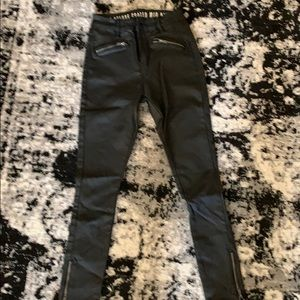 Leather coated skinny jeans